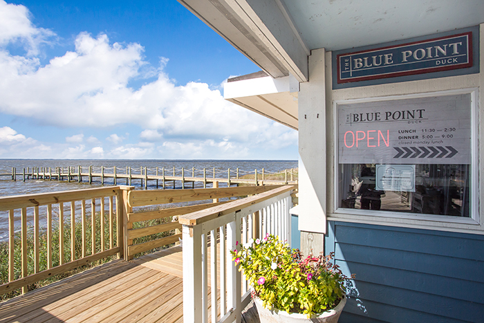 The Blue Point Restaurant | Duck, NC - A building with a wooden fence - Outer Banks